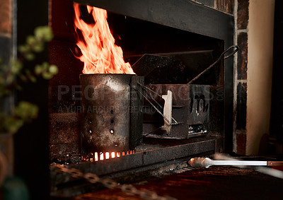 Buy stock photo Closeup shot of fire burning from a charcoal starter in a fireplace