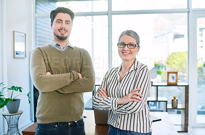 Buy stock photo Portrait of two businesspeople standing together with their arms crossed in an office