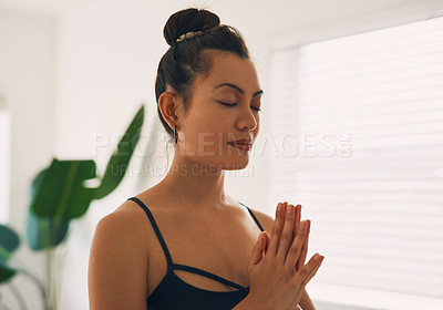 Buy stock photo Shot of a young woman practicing yoga at home