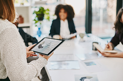 Buy stock photo Shot of a businesswoman using a digital tablet while giving a presentation in a boardroom