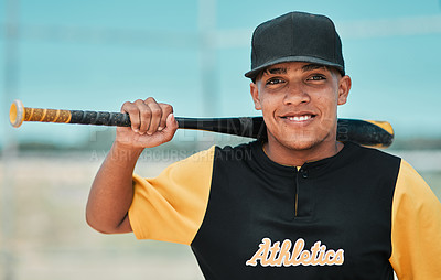 Buy stock photo Shot of a young baseball player holding a baseball bat while posing outside on the pitch