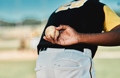Buy stock photo Rearview shot of a baseball player holding the ball behind his back