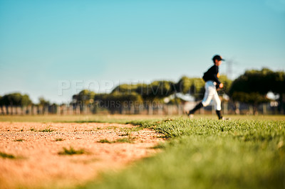Buy stock photo Defocused shot of a baseball player running during a game