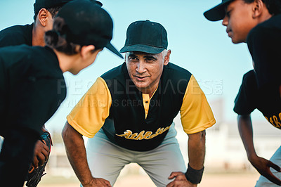 Buy stock photo Shot of a baseball coach talking to his team while out on the pitch