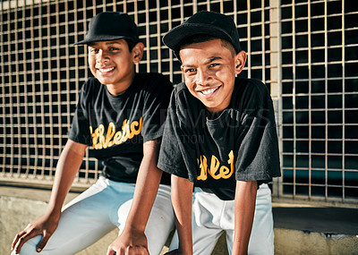 Buy stock photo Portrait of two young baseball players sitting together