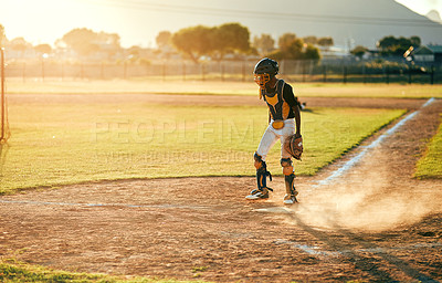 Buy stock photo Shot of a baseball player running during a match