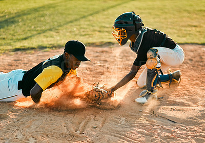 Buy stock photo Shot of a baseball player sliding to the base during a baseball game