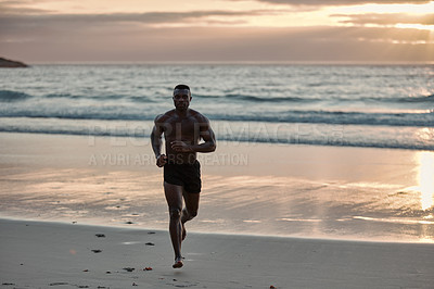 Buy stock photo Portrait of a muscular young man running at the beach