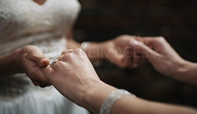 Buy stock photo Cropped shot of two unrecognisable women holding hands on their wedding day