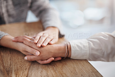 Buy stock photo Closeup shot of two unrecognisable people holding hands in comfort