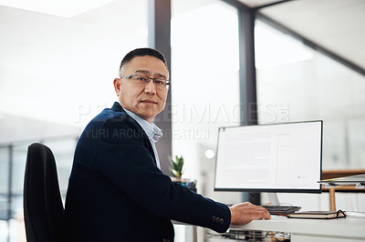 Buy stock photo Portrait of a mature businessman working in an office