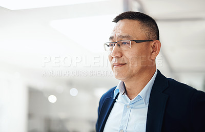 Buy stock photo Portrait of a mature businessman looking thoughtful while standing in an office