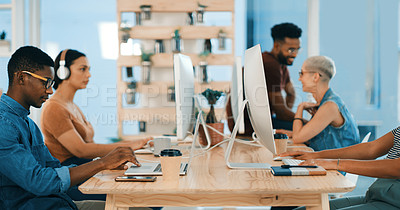 Buy stock photo Shot of a group of designers working in an office