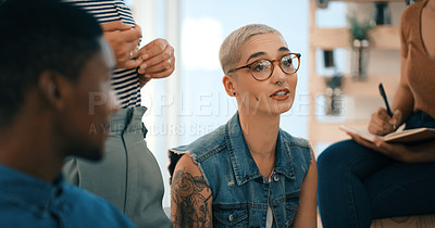 Buy stock photo Shot of a young designer having a discussion with her colleagues in an office