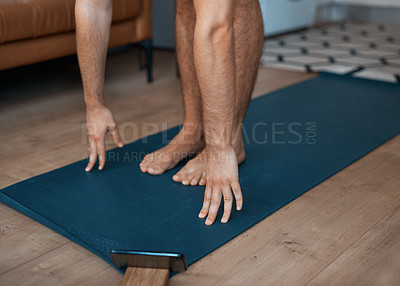 Buy stock photo Closeup shot of an unrecognisable man exercising at home