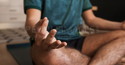 Buy stock photo Closeup shot of an unrecognisable man practicing yoga at home