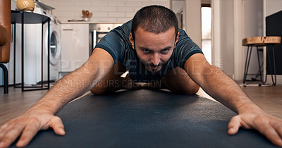 Buy stock photo Shot of a young man practicing yoga at home