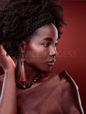 Buy stock photo Cropped shot of a beautiful young woman posing against a red background