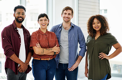 Buy stock photo Cropped shot of a group of designers standing together in an office