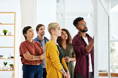 Buy stock photo Cropped shot of a group of businesspeople brainstorming in an office