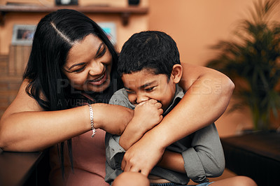 Buy stock photo Shot of a mother tickling her little son at home
