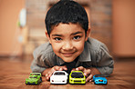 Showing off his collection of cars