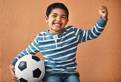 Buy stock photo Portrait of an adorable little boy posing with a soccer ball