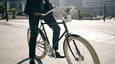 Buy stock photo Cropped shot of a businessman traveling through the city with his bicycle