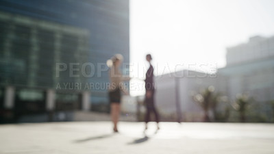 Buy stock photo Shot of two businesswomen shaking hands in the city