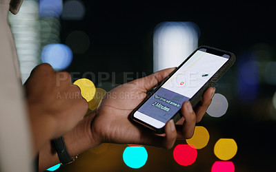 Buy stock photo Cropped shot of a businesswoman using a smartphone to order a cab in the city at night
