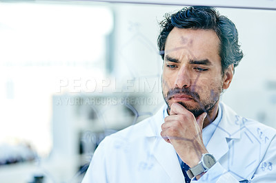 Buy stock photo Shot of a young scientist looking thoughtful while analysing notes on a glass wall in a lab