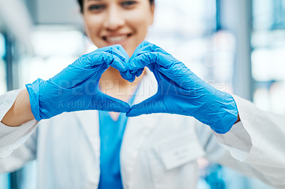 Buy stock photo Closeup shot of a young medical practitioner making a heart shape with her hands