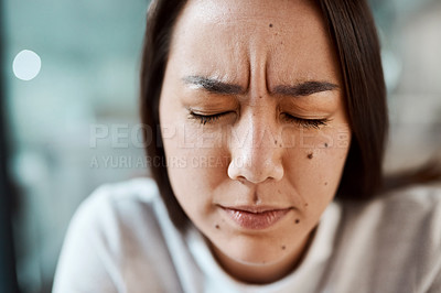 Buy stock photo Shot of a young woman closing her eyes in pain