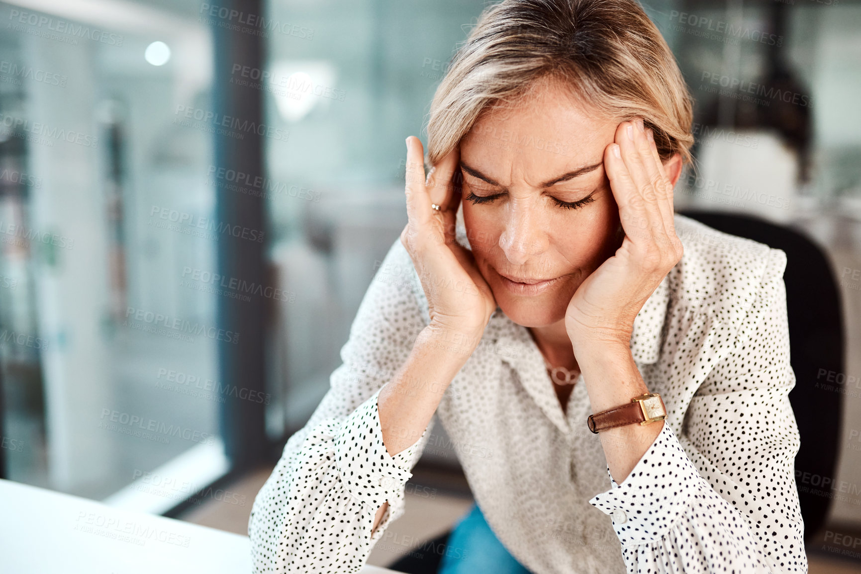 Buy stock photo Shot of a mature businesswoman looking stressed out while working in an office