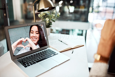 Buy stock photo Shot of a young woman making heart shape with her hands while appearing on a laptop screen during a video call
