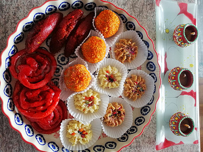 Buy stock photo Shot of a selection of delicious Indian Diwali sweet meats served on a tray