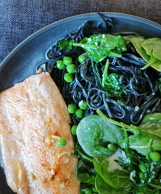 Buy stock photo Shot of hake served with squid ink linguini and fresh greens