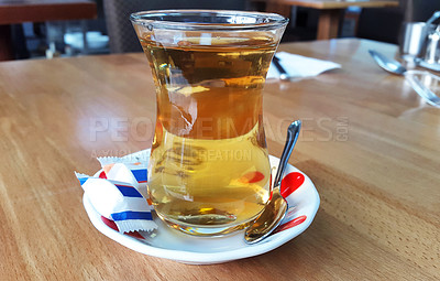 Buy stock photo Shot of a glass of freshly made tea outdoors on a table