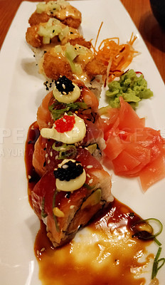 Buy stock photo Shot of sushi served on a platter in a restaurant