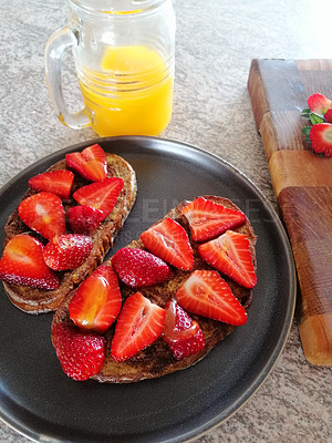 Buy stock photo Shot of hand picked strawberries served on freshly made slices of toast