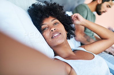 Buy stock photo Cropped shot of a woman taking a selfie while lying in bed with her boyfriend