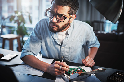 Buy stock photo Cropped shot of a young engineer working from home