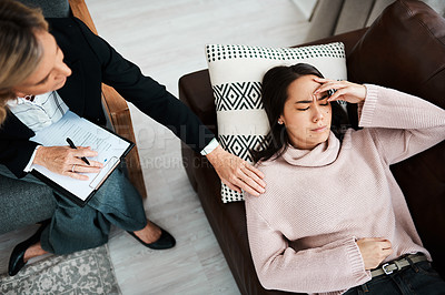 Buy stock photo Shot of a young woman having a therapeutic session with a psychologist