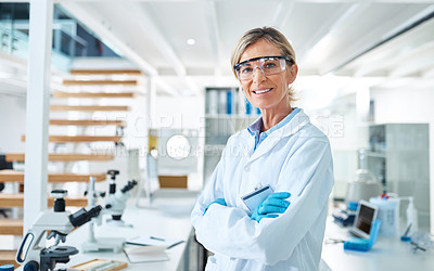 Buy stock photo Portrait of a mature scientist standing with her arms crossed in a lab