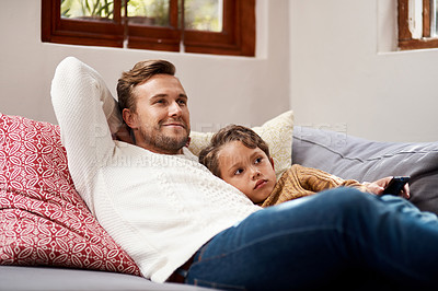 Buy stock photo Shot of a man and his son relaxing on the couch at home