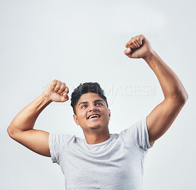 Buy stock photo Studio shot of a young man posing against a white background