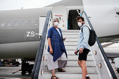 Buy stock photo Shot of a young man and senior woman wearing masks and boarding an airplane together
