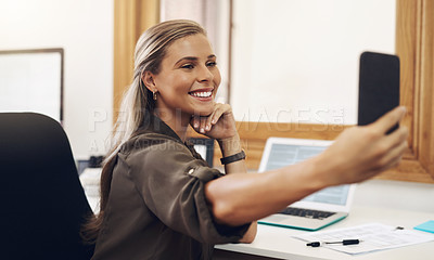 Buy stock photo Shot of a young businesswoman taking selfies in an office