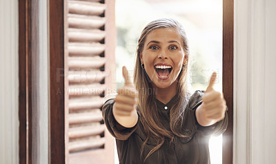 Buy stock photo Portrait of a young businesswoman showing thumbs in an office