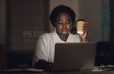 Buy stock photo Shot of a young businesswoman having coffee and using a laptop during a late night at work